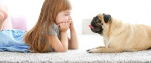 Girl and Dog on Carpet